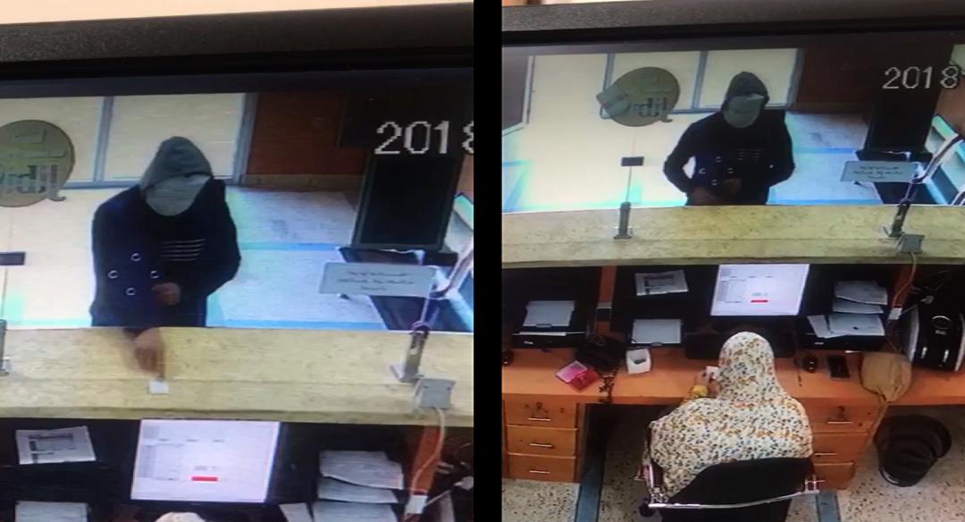 حصري وبالفيديو..ملثم يحاول سرقة وكالة بنكية تحت التهديد  باستعمال السلاح
